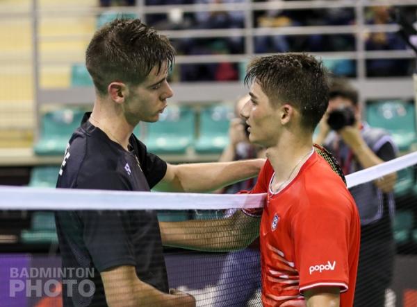 2020  French National Championship men's singles runner-up Arnaud Merkle (left) congratulating champion Christo Popov
