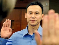 LOS ANGELES, CALIFORNIA SEPTEMBER 5, 2011-Olympic badminton hopeful Tony Gunawan raises his right hand as a judge swears him in as a U.S. citizen at the Royball Federal Courthouse in Downtown Los Angeles Times. (Wally Skalij/Los Angeles Times)